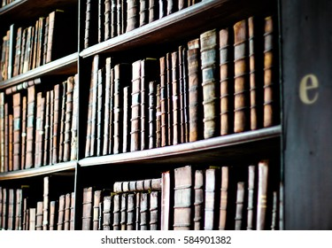 Closeup of books on a library shelf clicked in Dublin, Ireland at the Book of Kells Exhibition