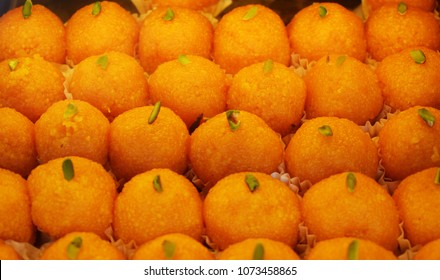 A closeup of Boondi Laddo with slice of Pista on it. A very popular indian sweet dish also known for its liking by Hindu Diety Lord Ganesha.