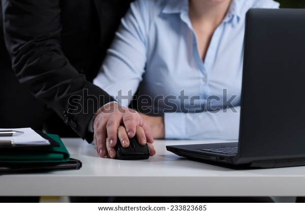 Close-up of boss mobbing his employee at work
