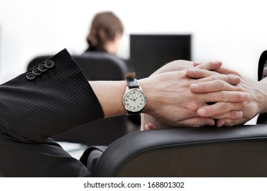 A closeup of a boss supervising his female employee