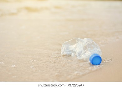 Close-up bottle plastic garbage on the beach