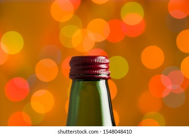 Close-Up Of A Bottleneck With A Cap On A Blurred Colorful Background, Selective Focus