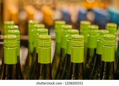 Close-up of bottlenecks in bottles in a drawer