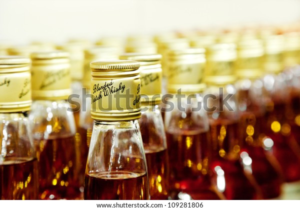 closeup of bottles of scotch blended whisky
