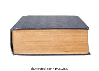 Closeup of the bottom edge of a book isolated on white background