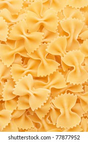 Closeup of Bow tie pasta Farfalloni forming a background