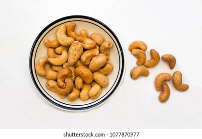 Closeup of a Bowl of Cashews on a White Background