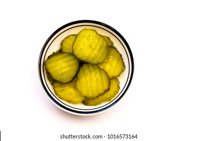 Closeup of a Bowl of Green Sliced Pickles on a white background