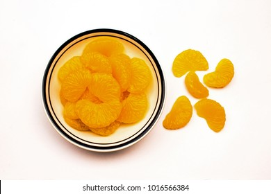 Closeup of a Bowl of Mandarin Oranges on a white background