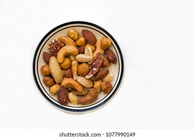 Closeup of a Bowl of Mixed Nuts on a White Background