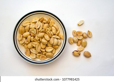Closeup of a Bowl of Peanuts on a white background