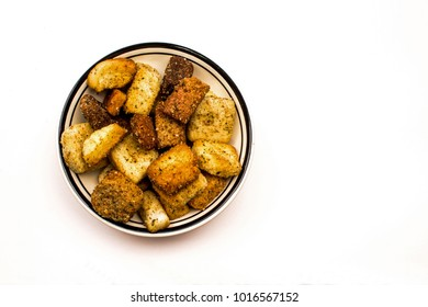Closeup of a Bowl of Toasted Croutons on a white background