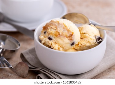 Closeup of a bowl of vanilla caramel ice cream and chocolate covered pecans