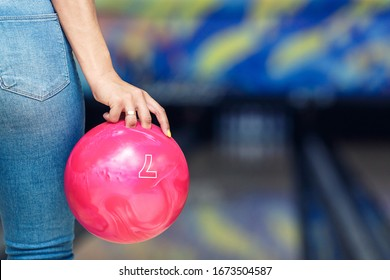 Close-up of a bowling ball in a girl's hand