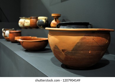 A close-up of bowls / artefacts from ancient Greece exhibited in a museum.