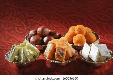 Close-up of bowls of traditional Indian sweets
