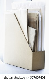 Closeup of box file filled with papers and envelopes