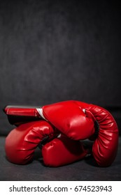 Close-up of boxing gloves in fitness studio