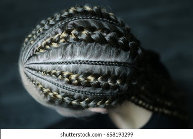 Close-up of braided hair, tight, thick braids in an African style