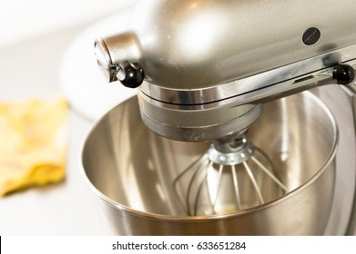 A closeup of bread Mixer In Bakery, mixing dough for baguettes in a bakery machine for mixing dough