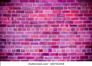 Close-up of brick wall with purple, pink, fuchsia, ultra violet, black color brick background