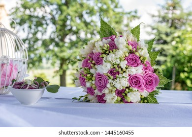 Closeup of bridal bouquet in nature. Detail of bridal ouquet from roses.