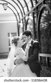 closeup, bride and groom hugging in the park. Black and white photo