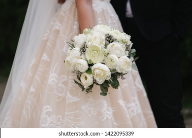 Closeup of bride hold bouquet in her hands