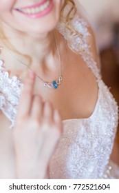 closeup bride with necklace focus on necklace