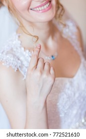 closeup bride with necklace focus on hand