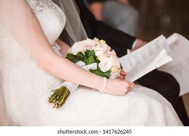 Close-up of bride reading wedding vows. Wedding ceremony.