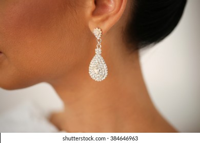 Closeup with bride's elegant crystal ear rings