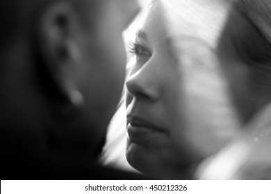 A closeup of bride's face while she looks at a groom