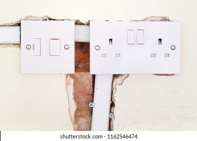 Closeup of a British electrical socket and switch during a domestic rewiring