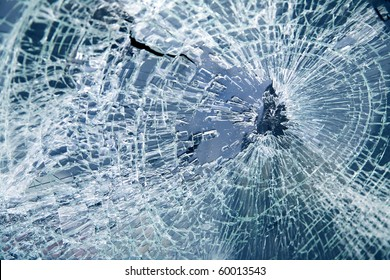 Close-up broken car windshield. Tint blue