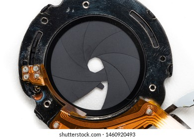 Close-up a broken electronic control aperture diaphragm on white bakground.