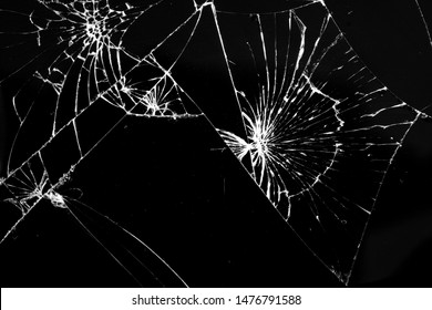 close-up of broken glass smartphone screen. many cracks and scratches on the surface