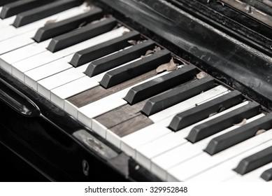 Close-up broken piano keyboard