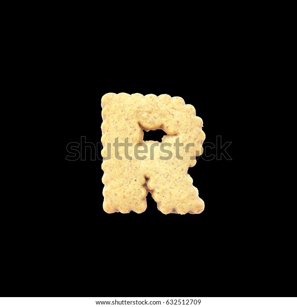 Closeup brown biscuit in R english alphabet isolated on black background with clipping path