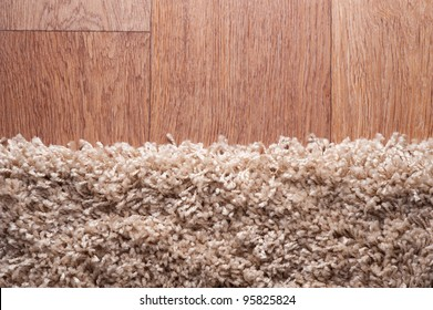 closeup of brown carpet on a wood surface