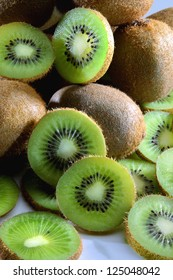close-up of brown kiwi with green slices