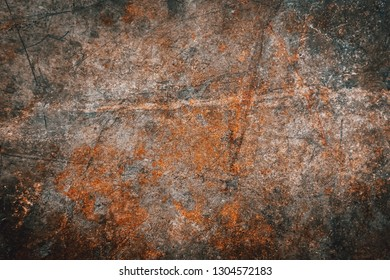 Closeup of brown metal rust grunge background texture. Rusted, old, vintage, retro background texture on brown metal or iron plate surface. Industrial obsolete concept image with Copyspace
