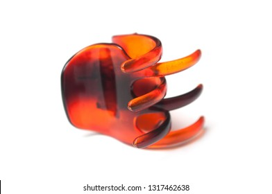 closeup of brown plastic hair clip on white background