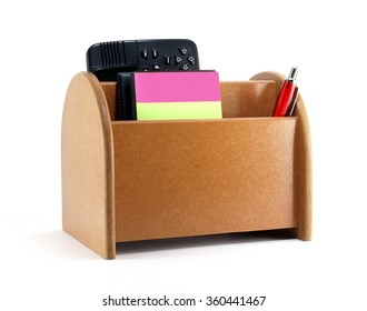 close-up brown plywood desk organizer with office supplies isolated on white background, office equipment that allows a tidy desk