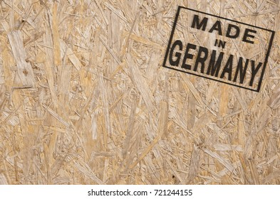 close-up of a brown pressed wood textured box with burn stamp Made in Germany on it