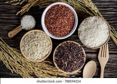 Closeup Brown rice, Black Jasmine rice,  and Rice berry in bowl on wooden desk.