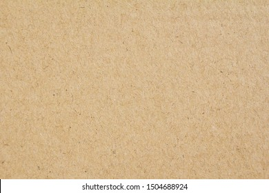 Closeup brown sheet of craft cardboard paper texture background.