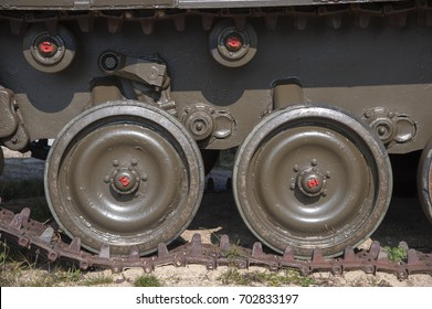 Closeup of the brown tracks of an army tank