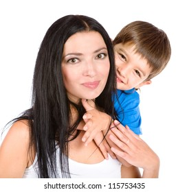 Close-up of brunette mother giving her son piggyback ride. isolated on white background