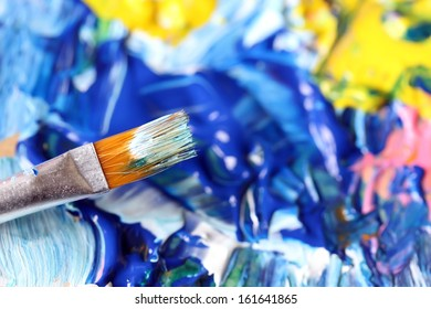 Closeup of brush and palette.